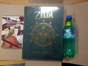 The Legend of Zelda: Hyrule Historia and Ace Attorney Investigations: Miles Edgeworth vol. 4. Bottle for size comparison.
