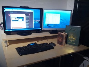 My new desk with monitor stand. And some books.