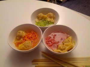Dumplings with colorful noodles